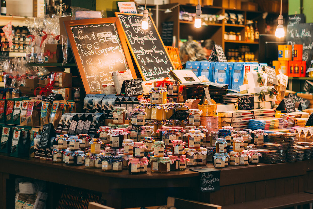 Cork, Ireland - English Market, a municipal food market in the center of Cork, famous tourist attraction of the city: table with jars of different jams.