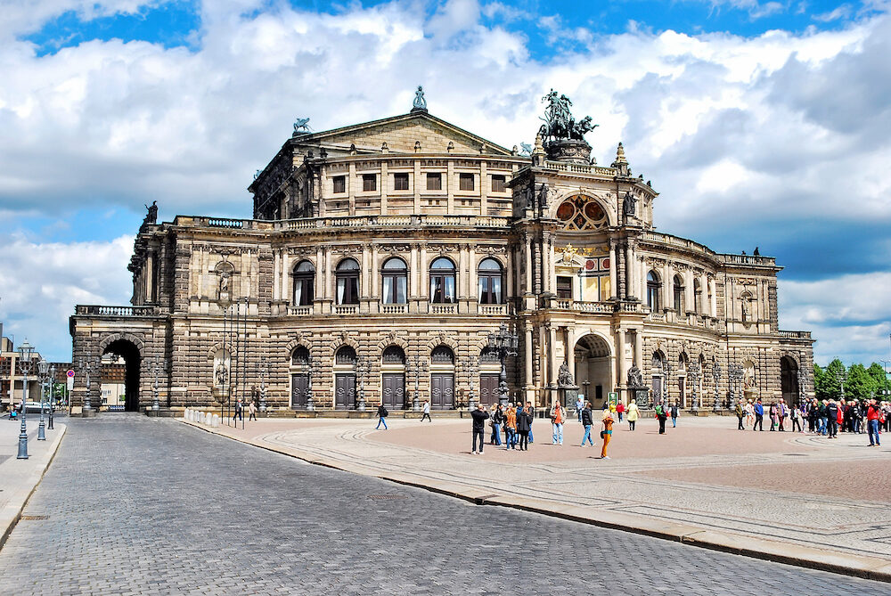 Dresden, Germany. Dresden State Opera, Semper Opera House on a sunny day with clouds in the sky. The Opera House in Dresden. Designed by Gottfried Semper. Located in the Old Town