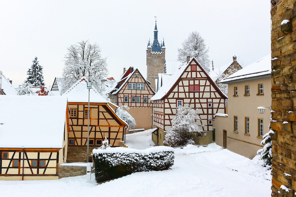 Historic, medieval half-timbered houses and old tower in Bad Wimpfen, Germany. Winter photo.