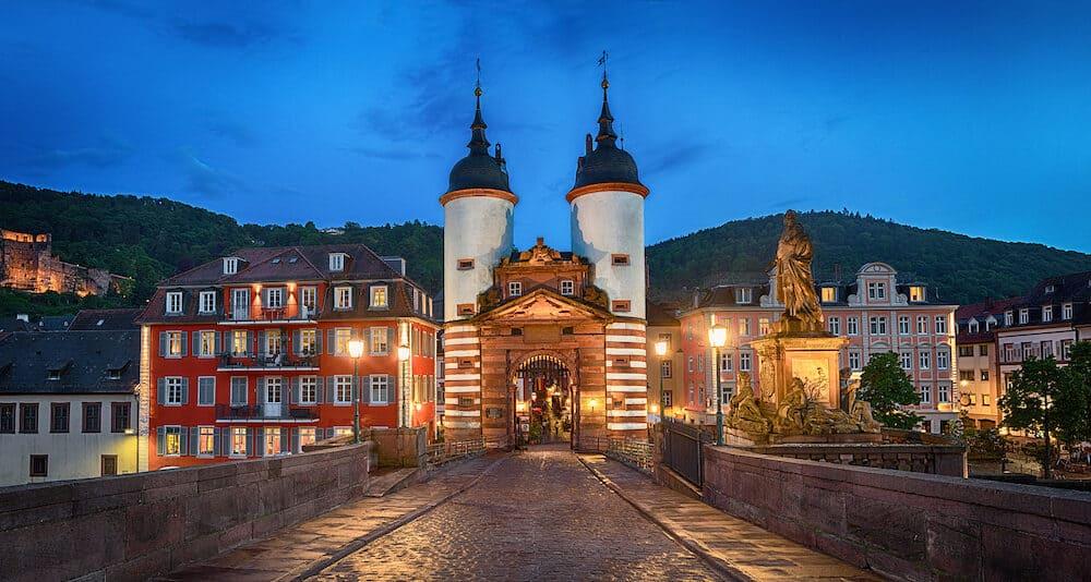 Illuminated Old Bridge Gate on Karl Theodor Bridge in Heidelberg Baden-Wurttemberg Germany