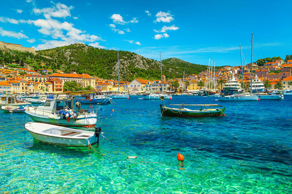 Popular travel and beach vacation destination. Well known medieval historic town with luxury yachts, sailing boats and fishing boats, Hvar town, Hvar island, Dalmatia, Croatia, Europe