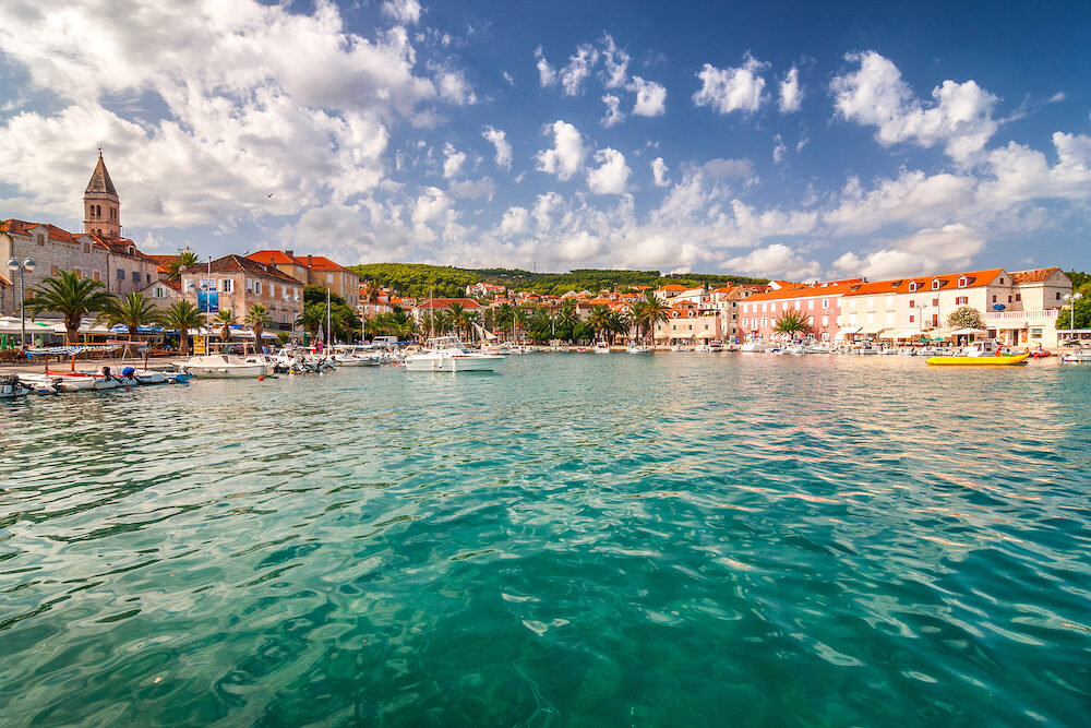 The Supetar harbor at sunny day on the Brac island, Croatia, Europe.