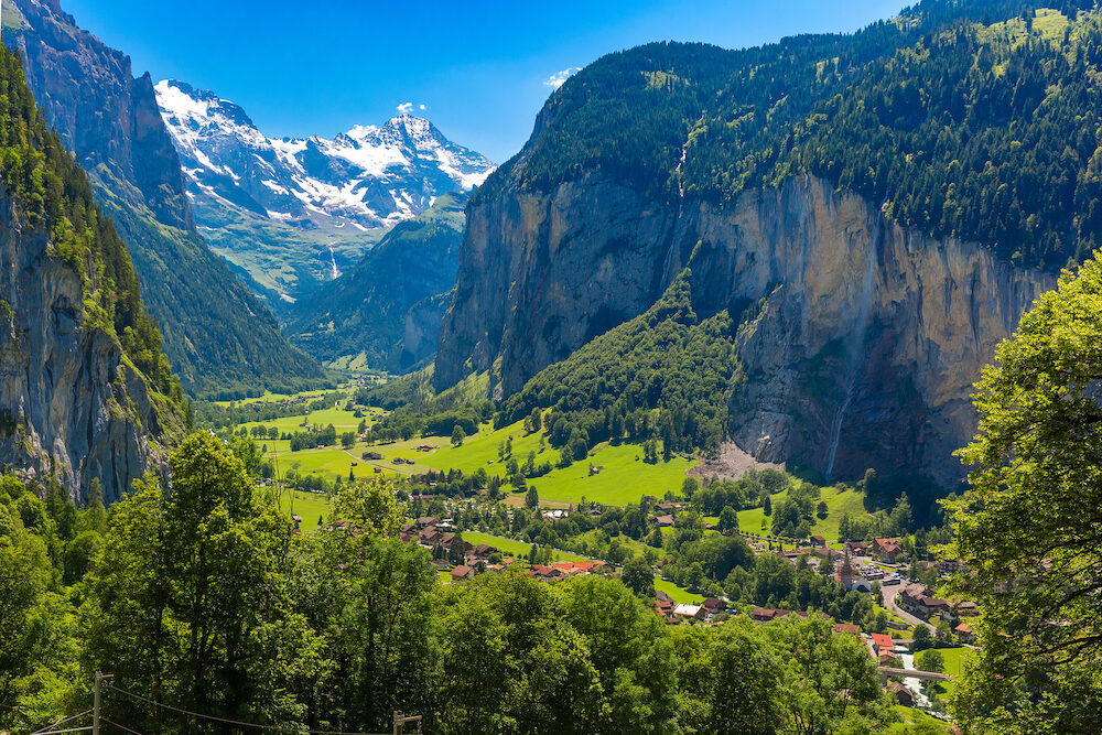 Lauterbrunnen valley, village of Lauterbrunnen, waterfalls and the Lauterbrunnen Wall in Swiss Alps, Switzerland.
