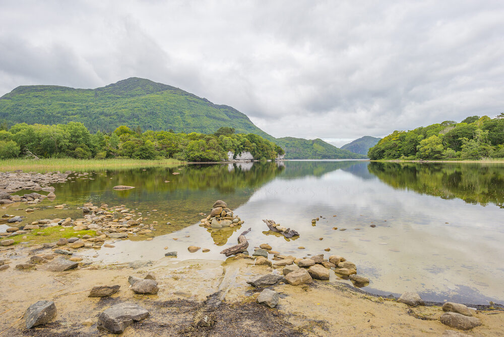 Panorama of shore and surroundings of a lake in a national park in Ireland