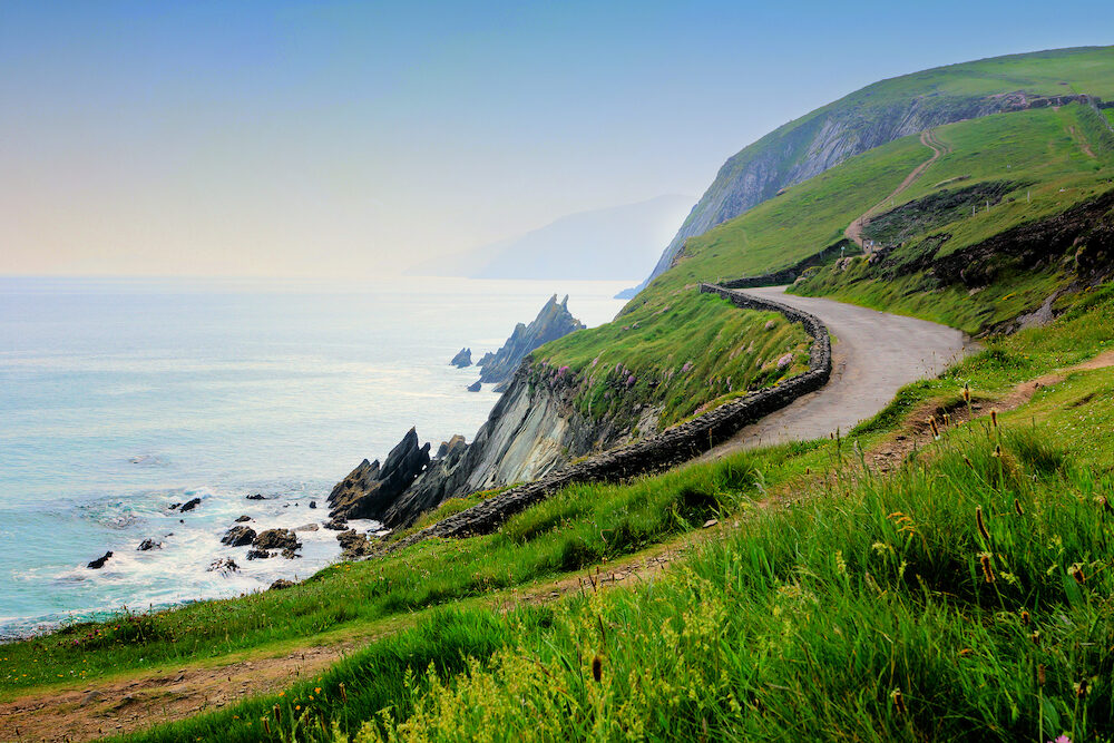 Road along the scenic coast of western Ireland. Slea Head, Dingle peninsula, County Kerry.