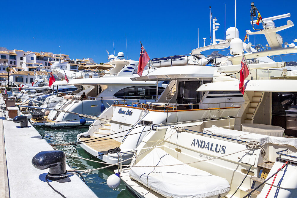 PUERTO BANUS, SPAIN - : Luxury yacht sterns at Puerto Banus, Nueva Andalucia, Marbella, Province of Malaga, Andalusia Spain