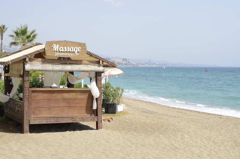 Marbella, Spain - Masage on the beach in Marbella, Andalusia, Spain.