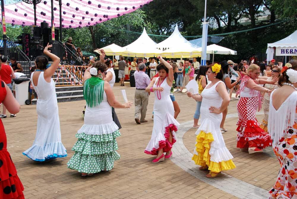 MARBELLA, SPAIN - Spanish women flamenco dancing during the Romeria San Bernabe festival Marbella Costa del Sol Malaga Province Andalusia Spain Western Europe