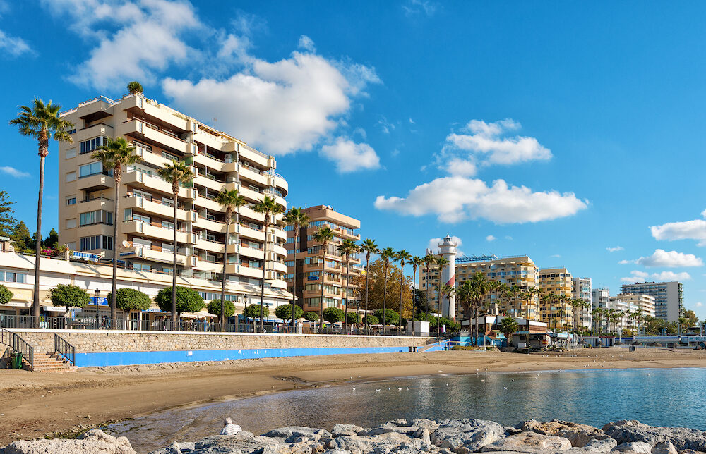 MARBELLA, SPAIN - Sunny Andalusian coastline with hotels and beautiful promenade along the waterline.