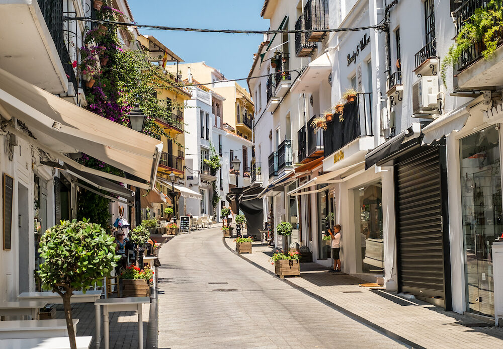 Marbella, Spain - the little photographer on old town street in Marbella, Costa del Sol, Andalusia, Spain, Europe