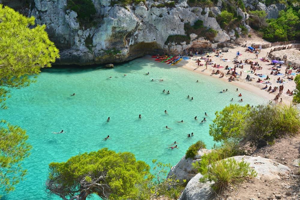 Beautiful beach with turquoise water in bay Cala Macarelleta on Menorca island in Spain.