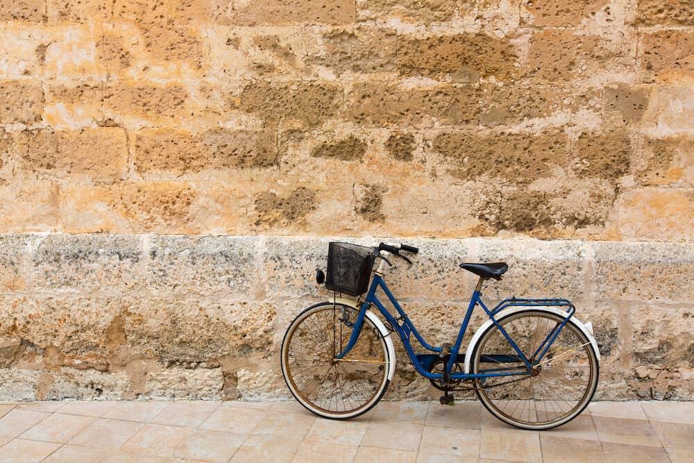 Bicycle in historical Ciutadella stone wall at Balearic islands