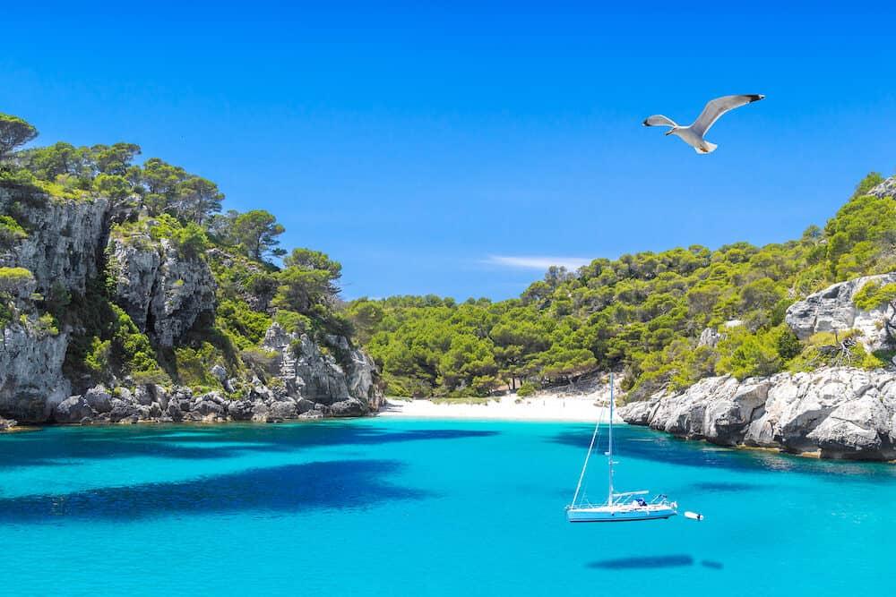Cala Macarelleta Beach with Turquoise Water of Mediterranean Sea. Menorca Island Travel Background.