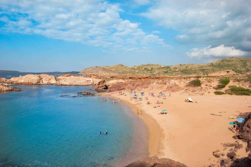 Sand beach with Caribbean sea in the north of Menorca island