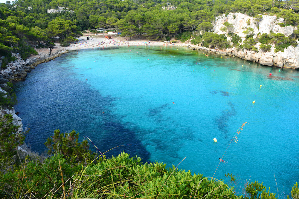 Turquoise water in bay Cala Macarella on Menorca island in Spain.