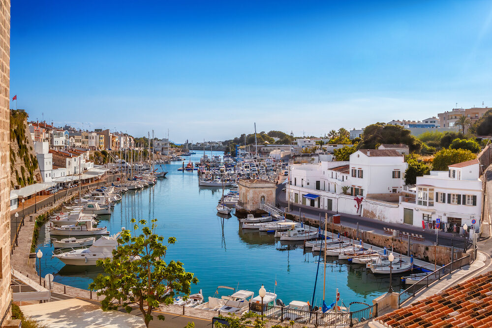 View on old town Ciutadella sea port on sunny day, Menorca island, Balears, Spain.