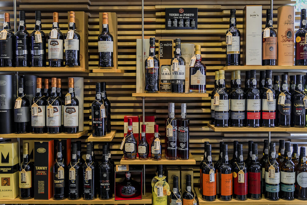 Porto, Portugal - Bottles of traditional port wine from famous producers on display in Porto Portugal