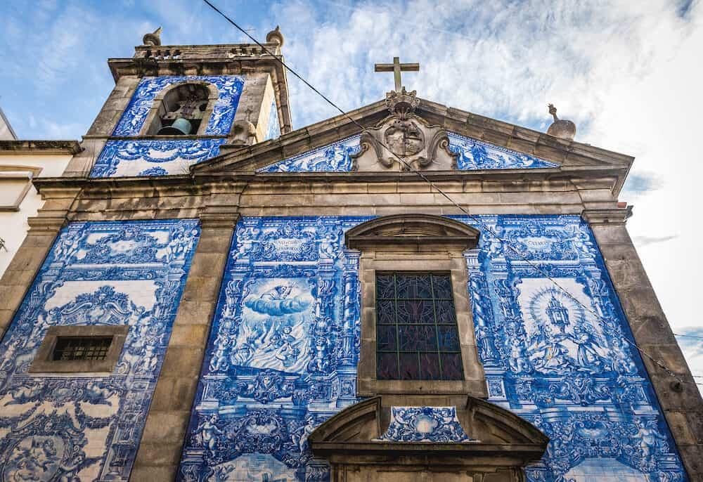 Porto Portugal - Characteristic tilework called Azulejo on Capela das Almas church in Porto
