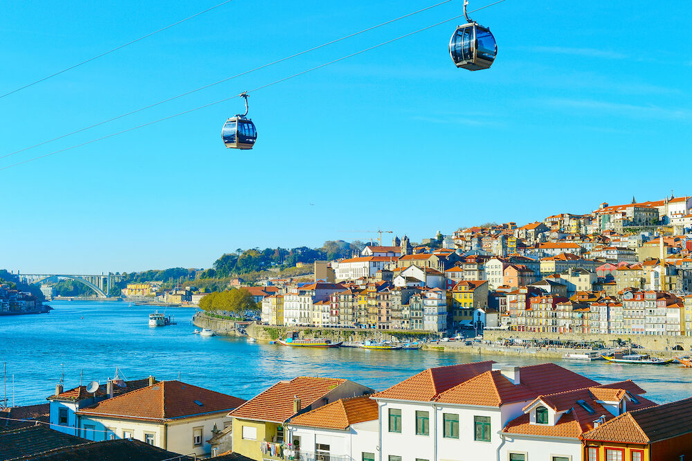 Cityscape of Porto Old Town with cable car in the foreground. Portugal