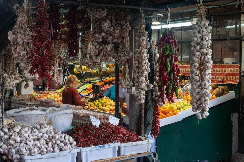 Porto, Portugal - People buying products at the traditional Bulhao Market (Mercado do Bolhao) in the city of Porto, Portugal