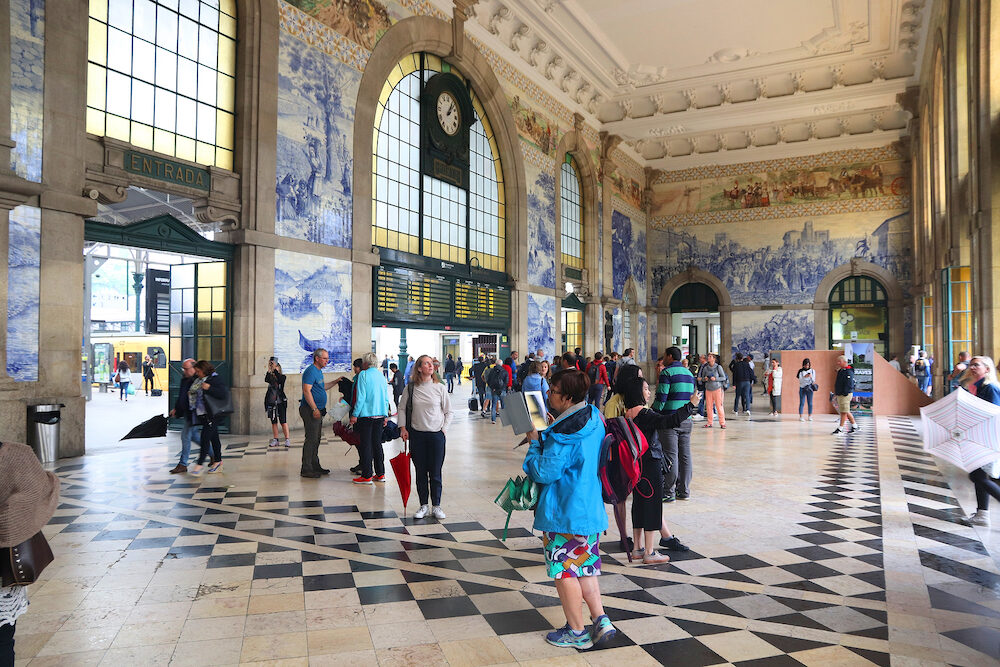 PORTO, PORTUGAL - People visit Sao Bento Station in Porto, Portugal. The railway station dates back to 1864 and is one of main train stations in Portugal.
