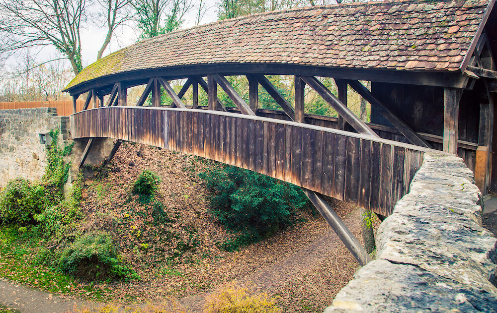 A wooden covered bridge in Rothenburg Germany