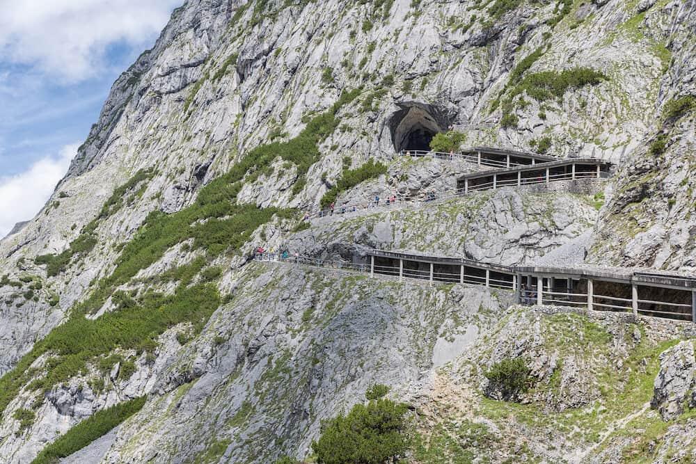 WERFEN, AUSTRIA - People walking at hiking trail through Austrian mountains near Werfen to ice cave Eisriesenwelt