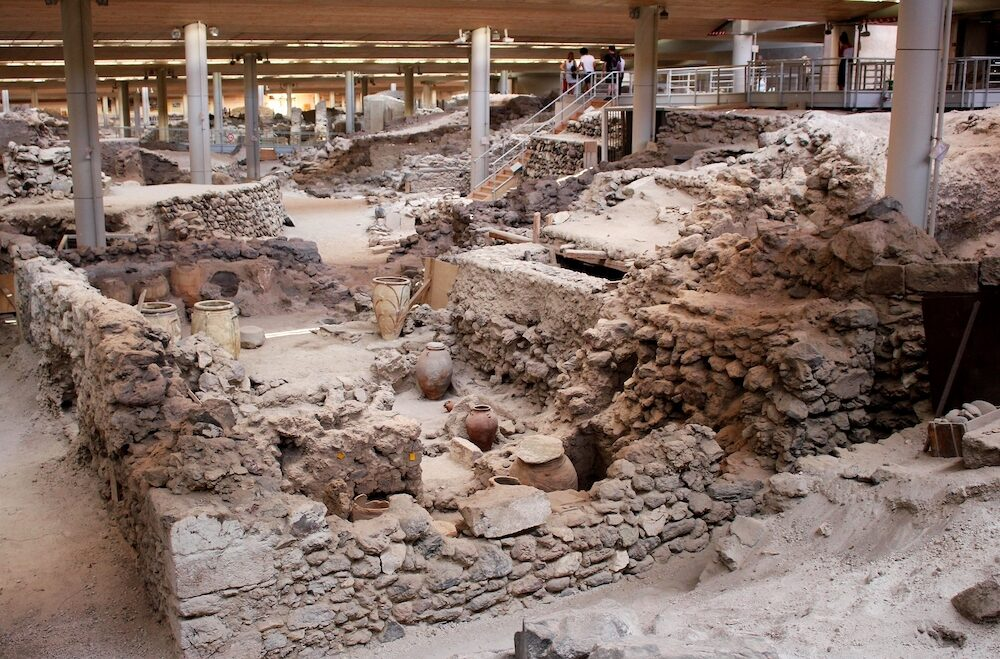 SANTORINI, GREECE - Akrotiri is an archeological site from the Minoan Bronze Age on the Greek island of Santorini (Thera). Photo of recovered ancient buildings and decorated pottery.