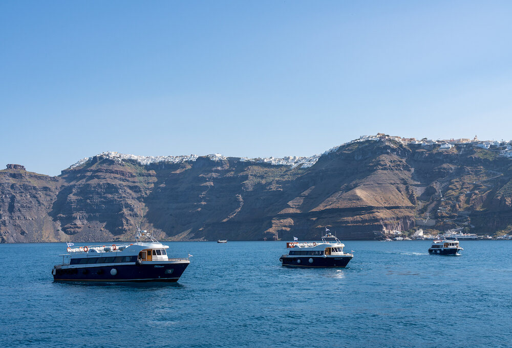 SANTORINI, GREECE - Tender ferry boats to bring tourists to island of Santorini