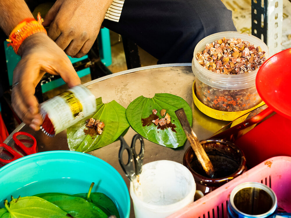 A man sells betel nut - a light chewable drug