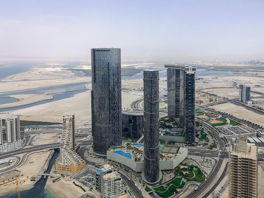 Aerial drone shot of Al Reem island Gate towers, Sun and Sky towers - Abu Dhabi city landmarks - Abu Dhabi, UAE