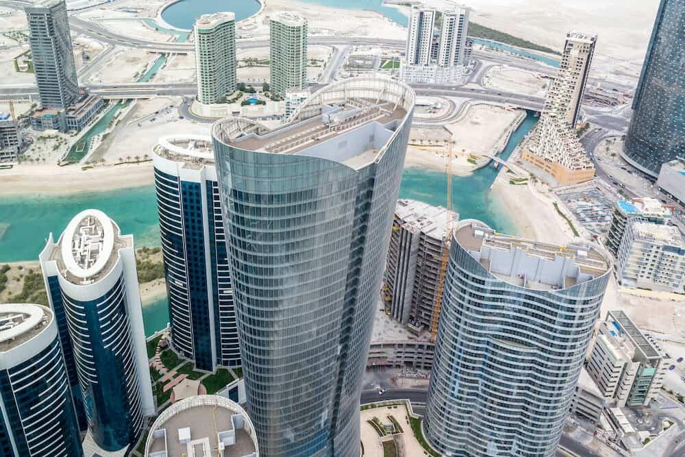 Aerial drone shot of skyscrapers and towers in the city - Abu Dhabi Al Reem island towers - Abu Dhabi, UAE,