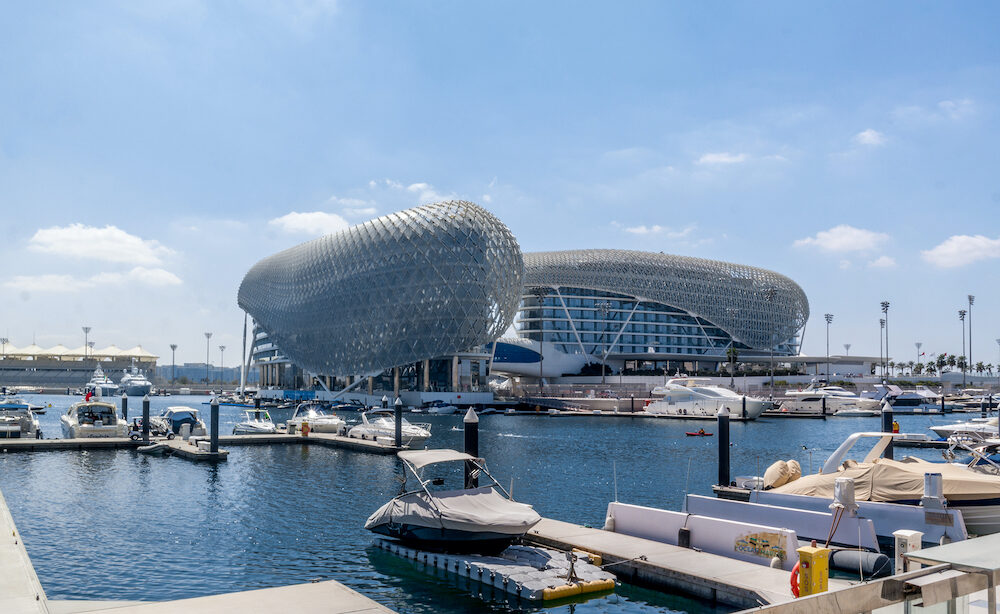 Yas Viceroy Hotel and Yas Marina Circuit, Abu Dhabi. The famous circuit is the venue for the Abu Dhabi Formula One Grand Prix and is built around two hotel buildings - Abu Dhabi, UAE