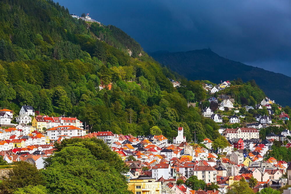 Bergen, Norway panoramic cityscape with colorful traditional houses and Mount Floyen
