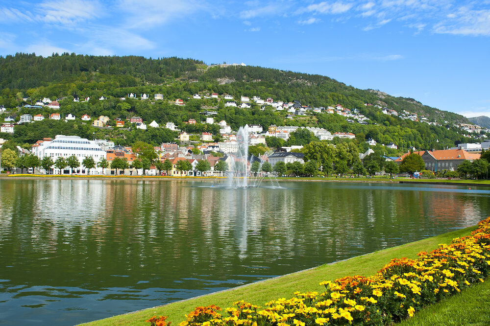 Bergen landscape with Floyen Mountain, colorful houses, fountain and Lille Lungegardsvannet or Smalungeren Lake in Hordaland county in Bergen, Norway
