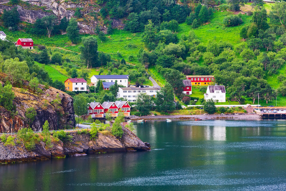 Norwegian fjord village and Sognefjord landscape in Flam, Norway. Tourism vacation and travel background