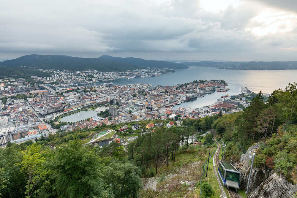 Panoramic view of Bergen and harbor from Mount Floyen, Bergen, Norway. Panorama of Bergen from the viewport on the mountain. The Norwegian city with a port in the evening. Cityscape.