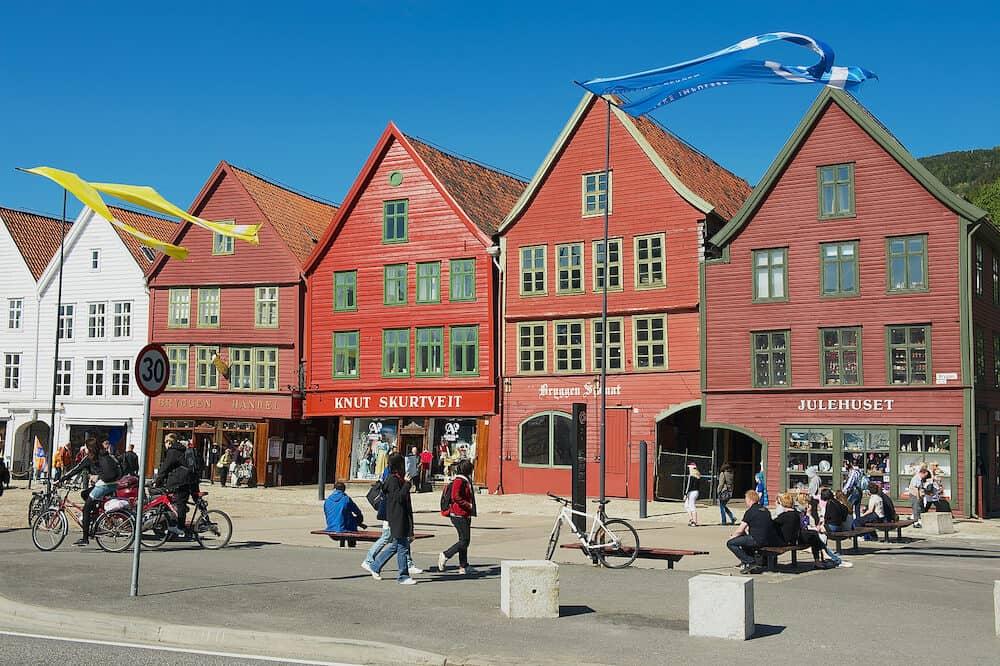 Bergen, Norway - Unidentified people walk at Bryggen historical quarter in Bergen, Norway. Bryggen is a UNESCO world Heritge site.
