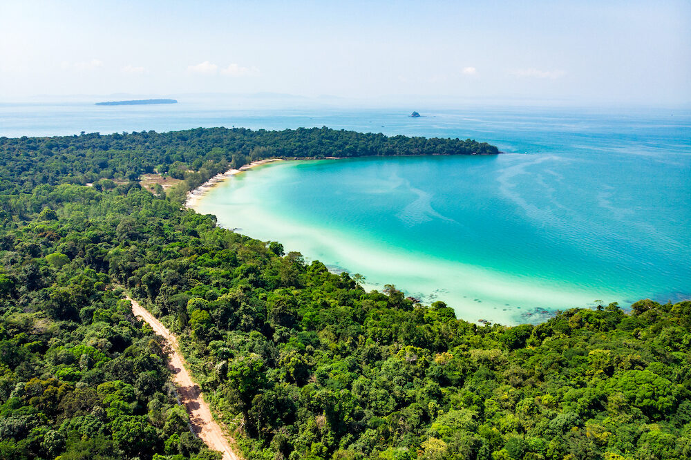 long beach in tropical paradise snake island near sihanoukville cambodia. Top view of a beautiful tropical island with dense forest or jungle.