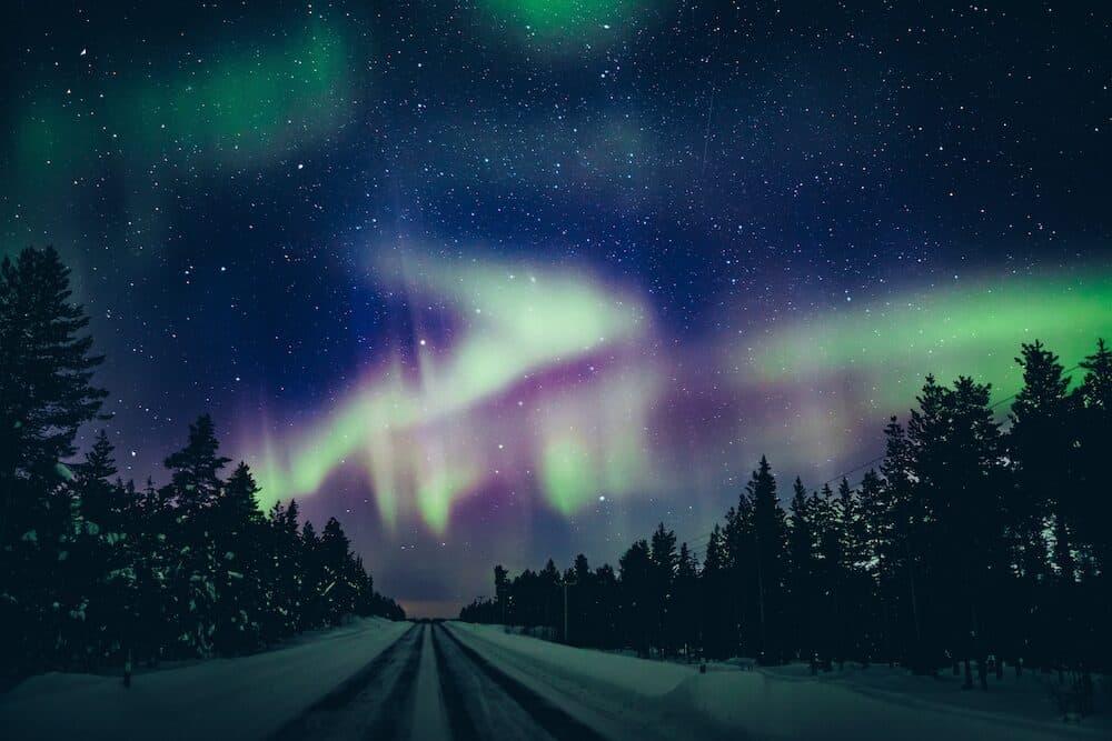 Colorful polar arctic Northern lights Aurora Borealis activity in winter Finland, Lapland