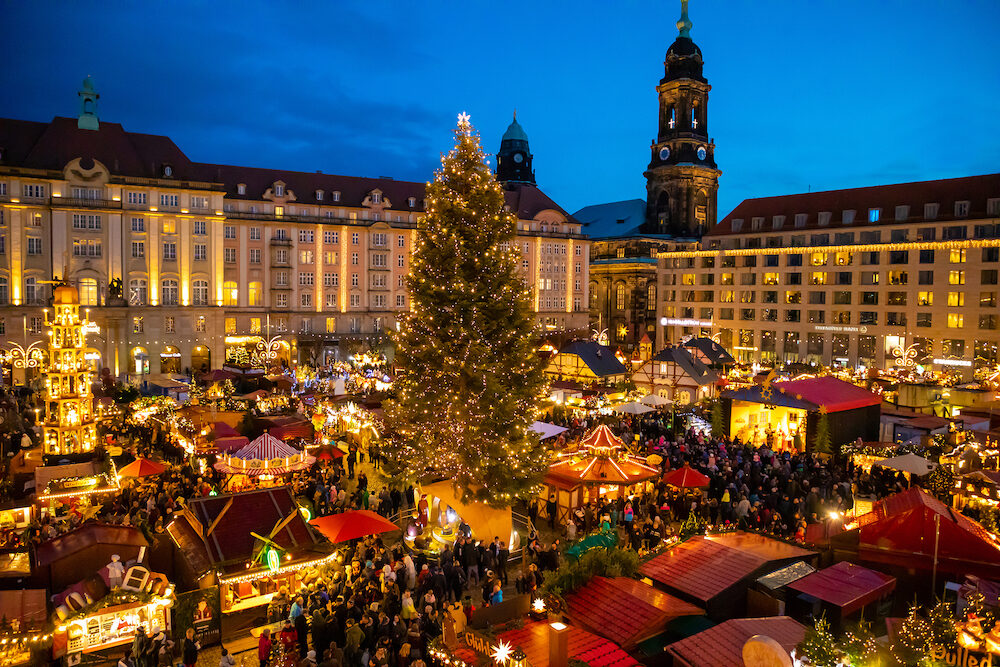 Dresden, Germany - People visit Christmas Market Striezelmarkt in Dresden, Germany. Christmas fair, European traditions