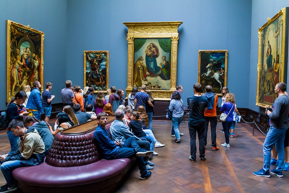 Dresden Germany - Tourists view the painting of Raphael's Sistine Madonna (C) in the Dresden Picture Gallery of Old Masters.