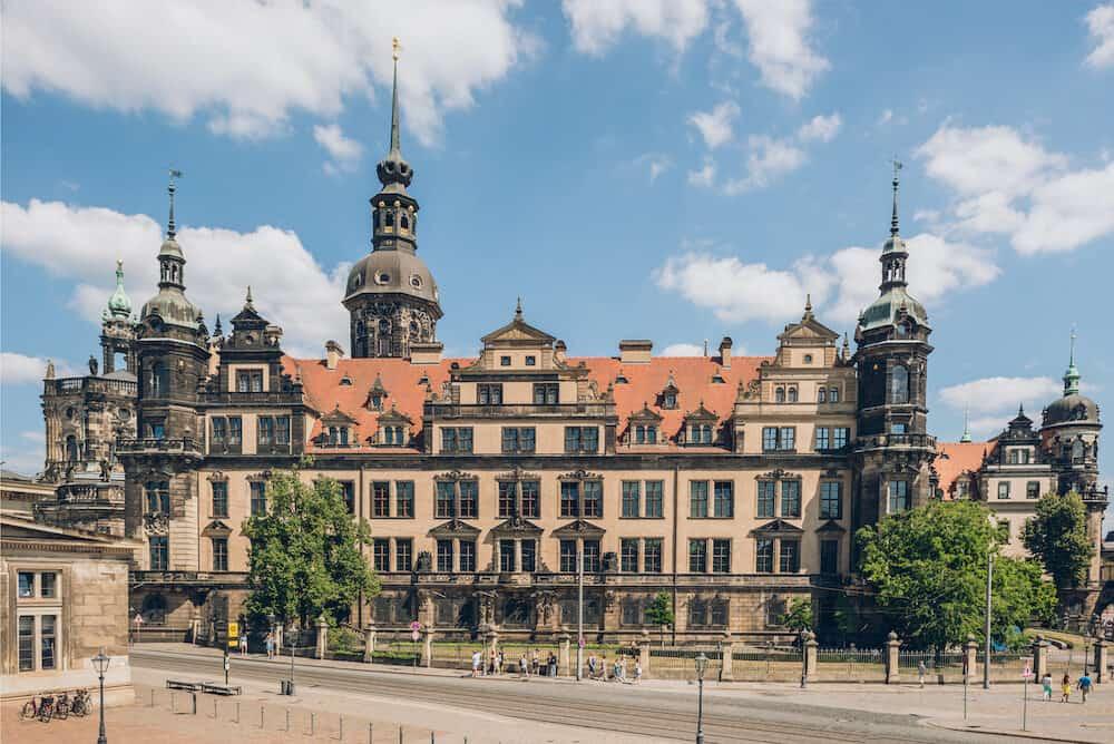 DRESDEN, GERMANY - people walking near beautiful Dresden Castle or Royal Palace in Dresden, Germany