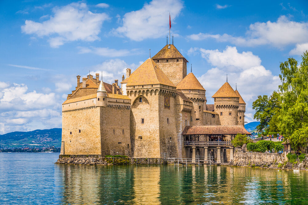 Classic view of famous Chateau de Chillon at beautiful Lake Geneva one of Switzerland's major tourist attractions and most visited castles in Europe Canton of Vaud Switzerland