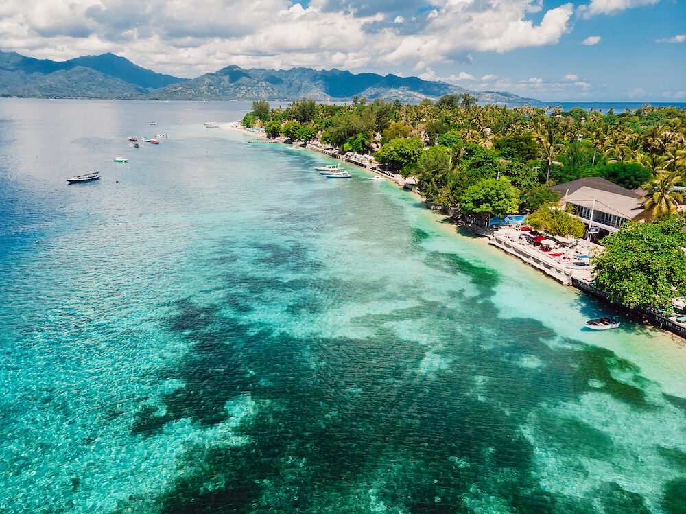 Beautiful tropical island with crystal ocean, aerial view. Gili islands