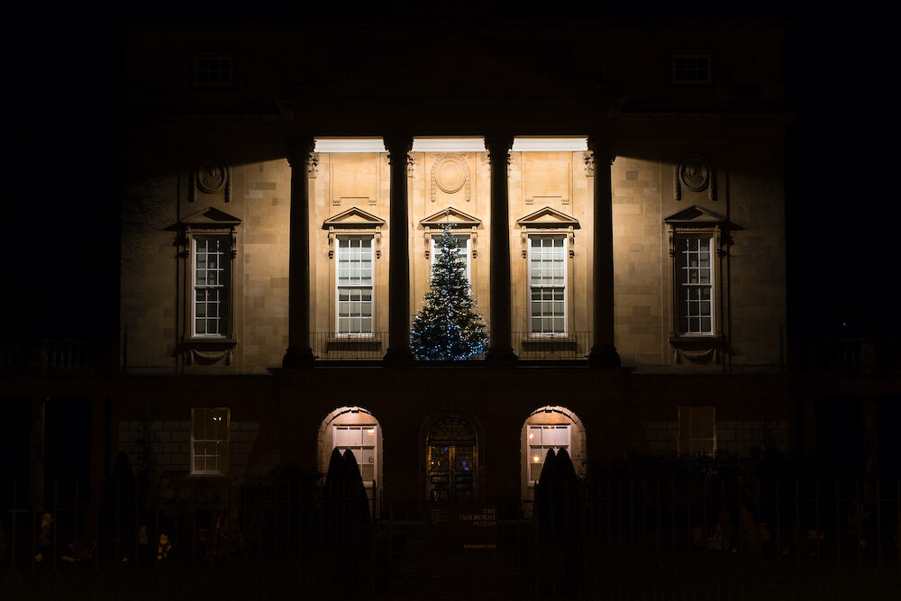 Holburne Museum in Bath at night, with Christmas tree. Festive decorations adorn the front of museum and art gallery in UNESCO World Heritage City in Somerset UK