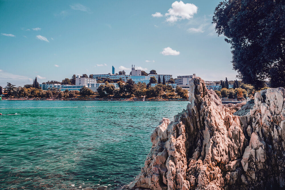 View from the coast in a green lagoon near the town of Porec on the Istrian Peninsula. Magnificent nature of the coast of Croatia