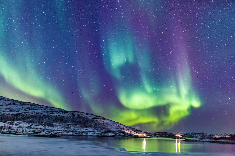Incredible Northern lights Aurora Borealis activity above the coast