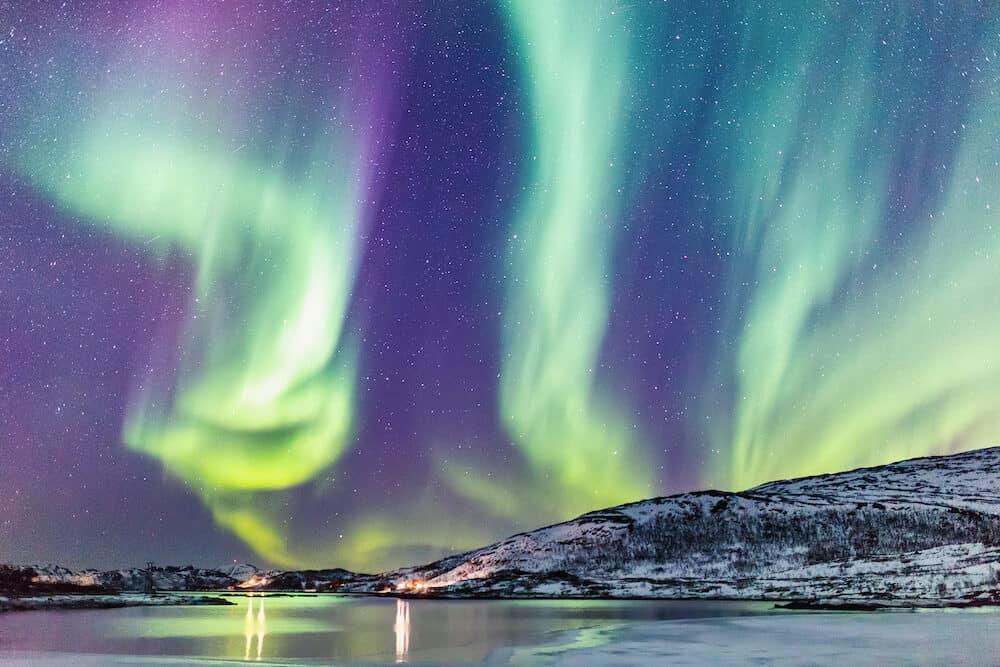 Incredible Northern lights Aurora Borealis activity above the coast