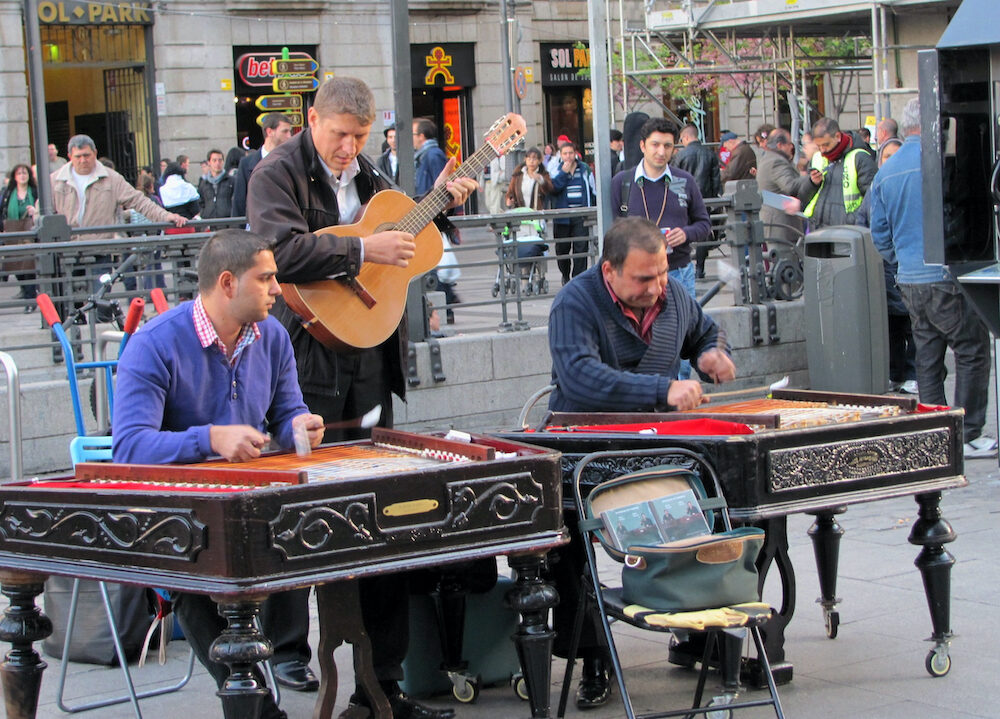 MADRID, SPAIN - Musicians playing different instruments perform on the Madrid street